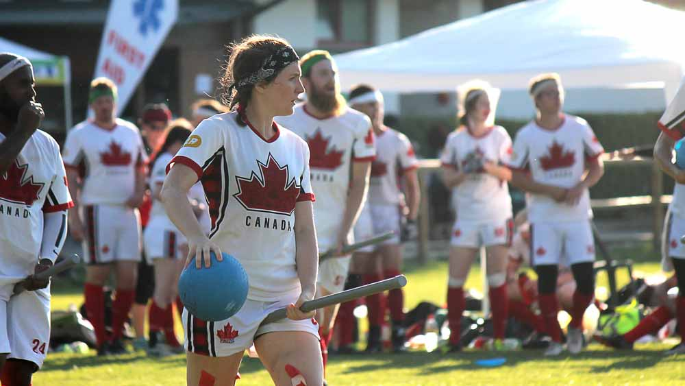 Female quidditch player wearing the 2018 Quidditch Canada light kit.