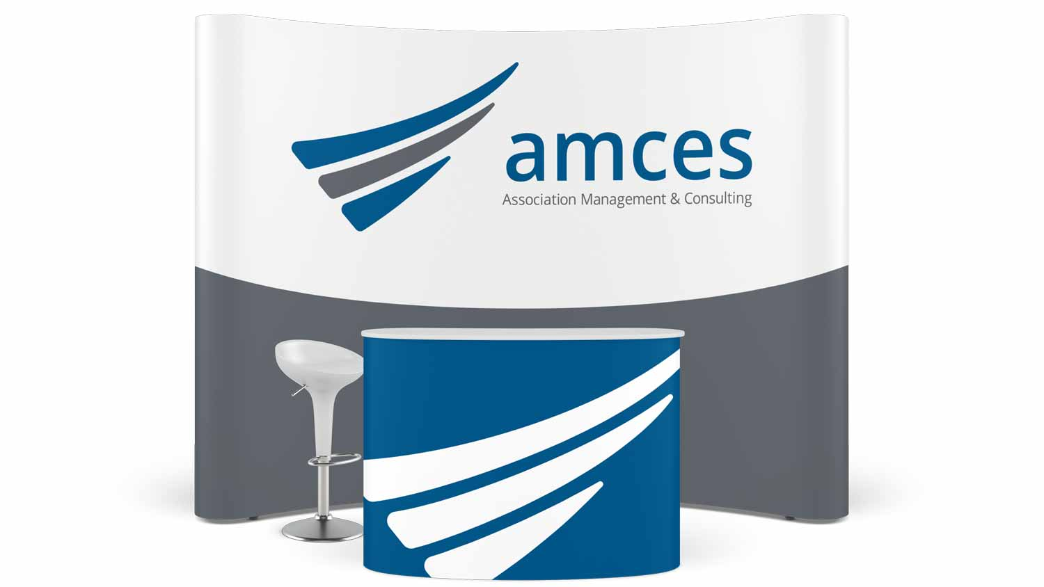 A conference booth with the AMCES branding.